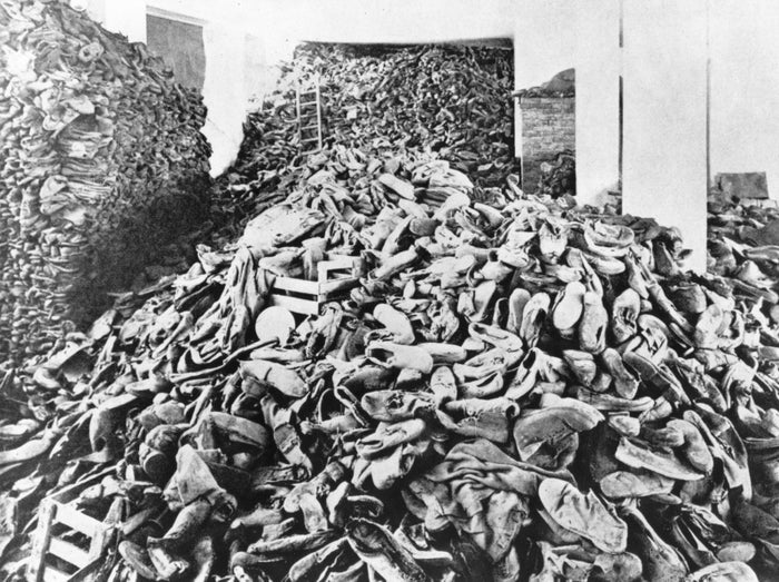 Shoes of murdered prisoners in a concentration camp, likely Treblinka or Belzec.