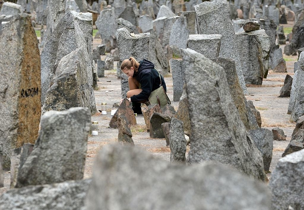 A Polish girl in front of the monument of the Treblinka Nazi death camp.