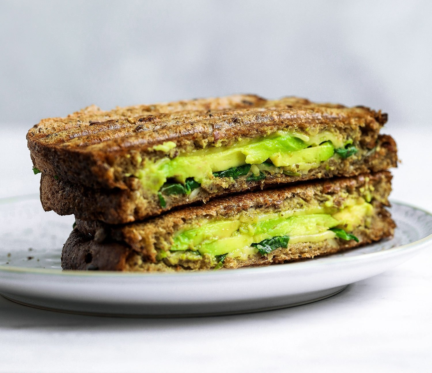 Why have a plain, ~regular~ grilled cheese when it could be loaded with greens and avocado, like in this recipe?