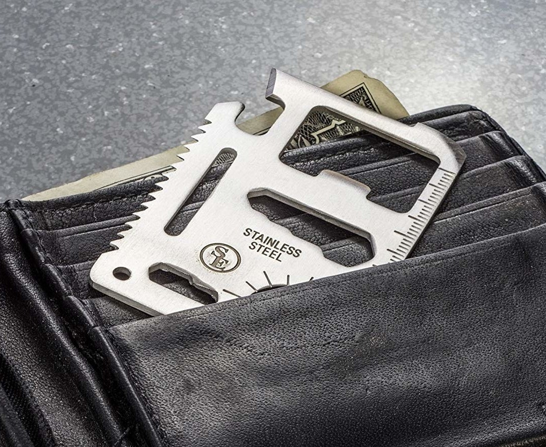 The tool sliding into a wallet pocket