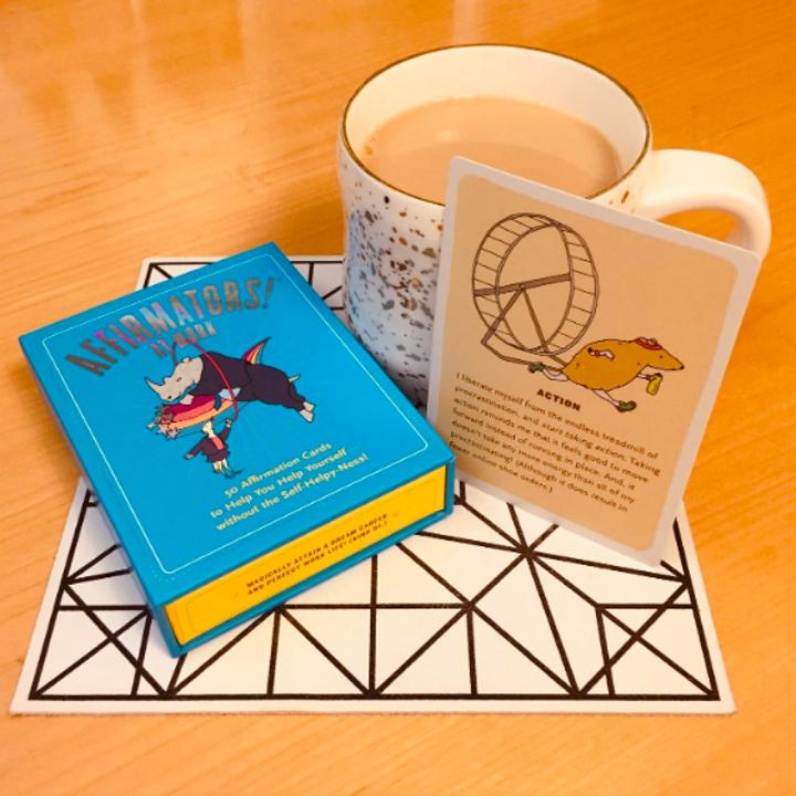 The box of cards next to a mug