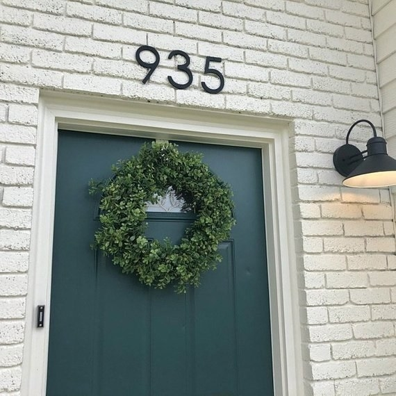 Front door with the numbers 935 in a large san serif font above it