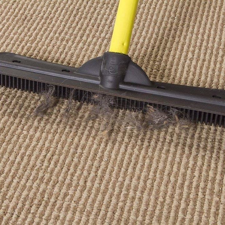 the squeegee's silicone bristles getting fir out of a carpet