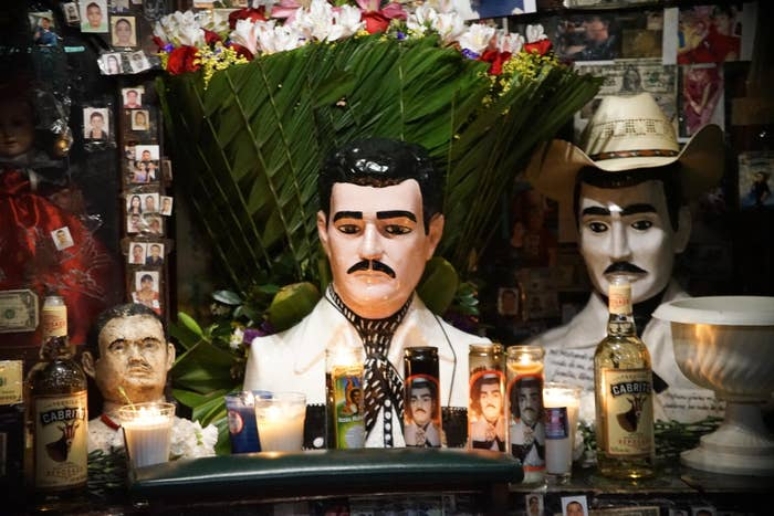 Candels at the chapel dedicated to Jesús Malverde, patron saint of narcos, in Culiacán, Mexico.