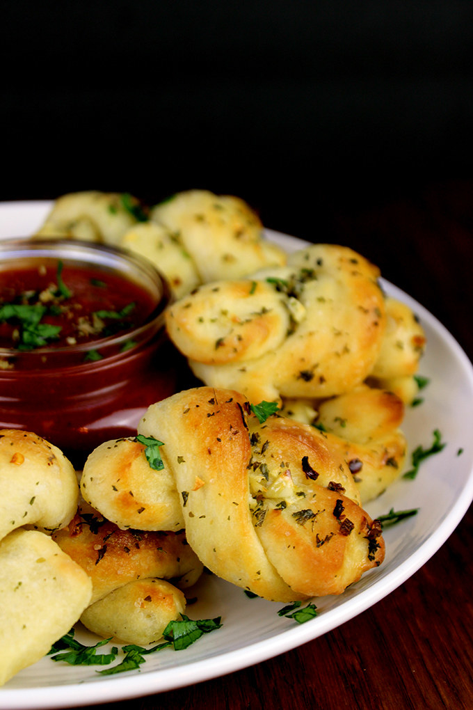 Form and presentation is everything when it comes to finger food. Take the classic garlic knot, which is more accessible than garlic bread, and infinitely more fun to chew and savor. Get the recipe.