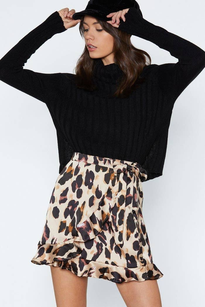 106a42b5f2 20. A leopard-inspired wrap skirt you'll be able to wear all 365 days a  year. This defies the concept of ~seasonal dressing~ and is perfect for  fall, ...