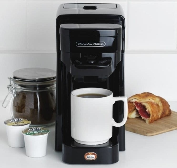 This is compatible with K-Cups, and other single-serve packs, as well as ground coffee. It has a 10 oz. capacity, an illuminated brew switch, and auto shut-off feature after the brewing cycle is complete.Get it from Walmart or Jet for $24.49.