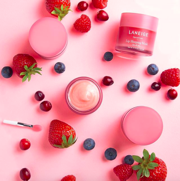 the lip sleeping mask in its tub surrounded by berries
