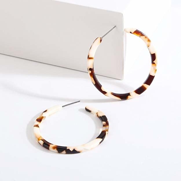 closeup of white/brown earrings