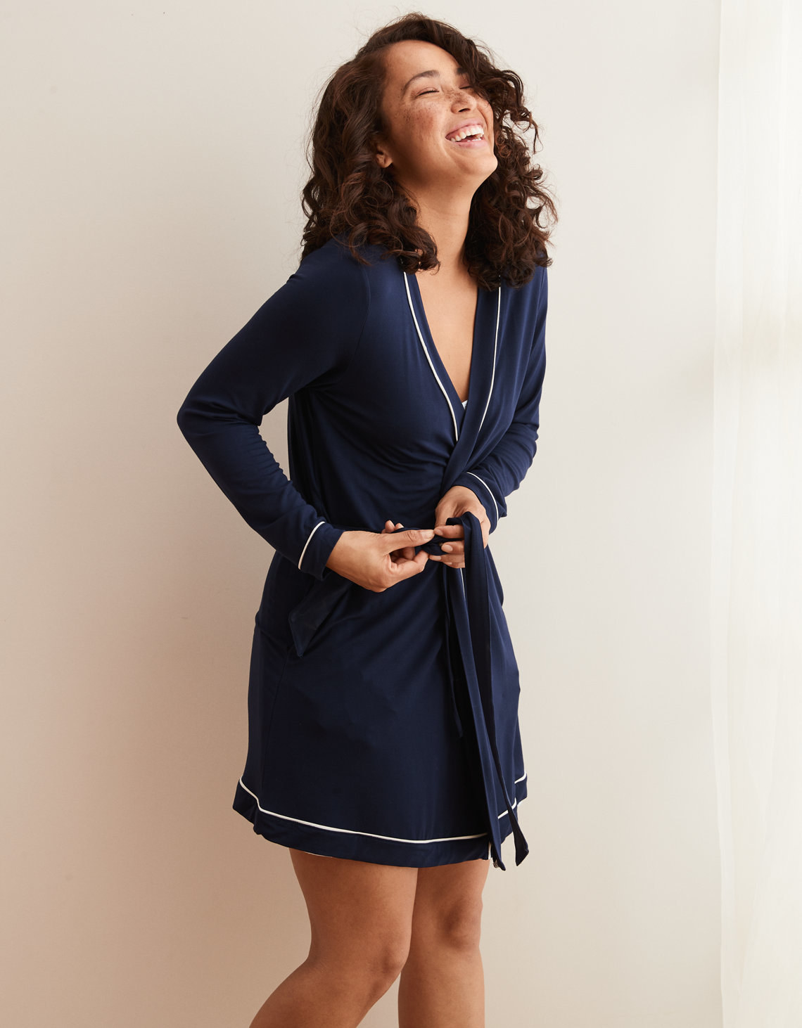 A luxuriously soft jersey or fleece robe with delicate piping checkered  detailing e82584c14