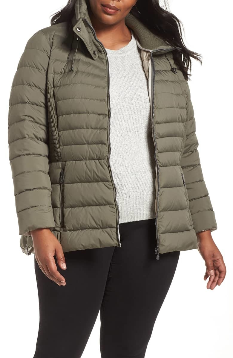 "Promising review: ""Really pleased with this jacket. It's warm, soft, stylish, and has great design features. I love the drawstring in the neck, so you can make it really snug and draftproof, I love the side shirring, and I love the side zippers. They are both functional and stylish."" —Fluff Get it from Nordstrom for $105.90 (originally $178.00, available in sizes 1X–3X)"
