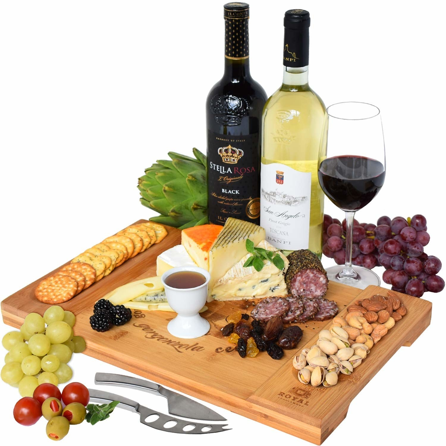 large wood cheese board full of charcuterie and crackers