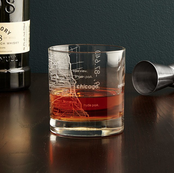 a cocktail in a glass etched with the chicago map