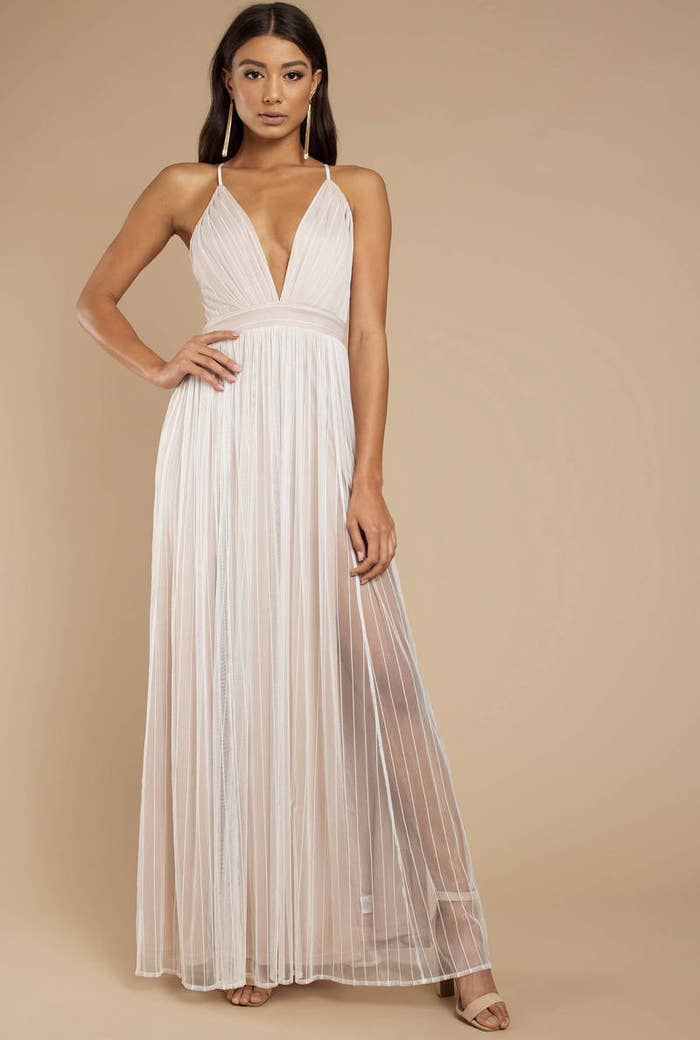 adade123c14b3 A tulle maxi with a plunging neckline for those who prefer a more  minimalist style — think of all the fun shoe, jewelry, and makeup options  you can try!