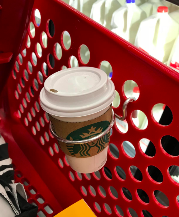 """Promising review: """"I go grocery shopping with a cart and attach this cup holder to hold Starbucks coffee. Love walking around, hands-free, have a sip of coffee every now and then — life is great."""" —stephen moody Get a set of two from Amazon for $12.99."""