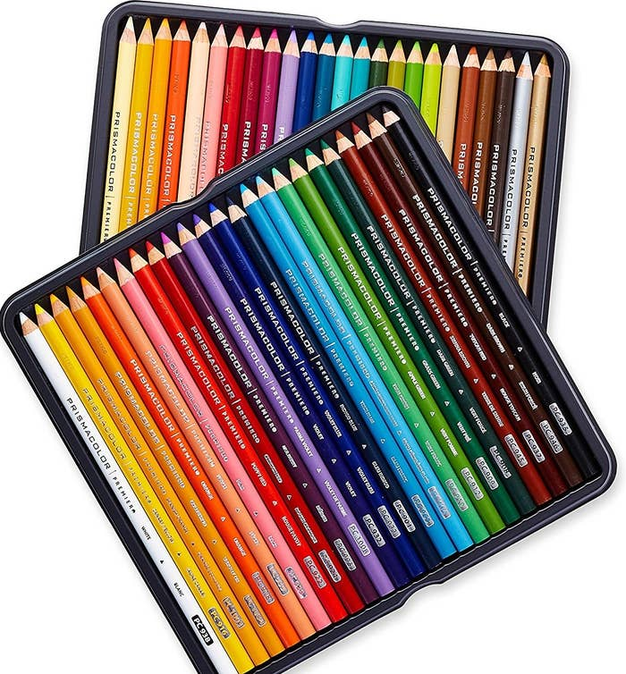Many colored pencils sitting in two square tins.