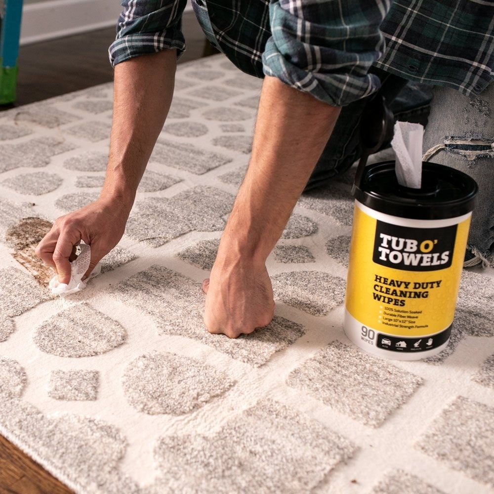 The heavy duty cleaning wipes cleaning a stained carpet