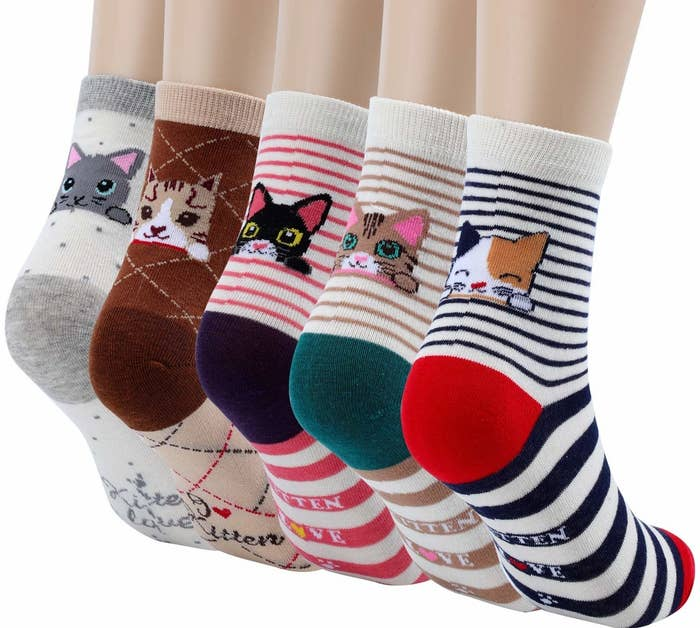 The five socks in different colors, each with contrasting heel and toe colors and different kitties peeking over the heel. Three of the pairs are striped, one has little polka dots, and another has checks