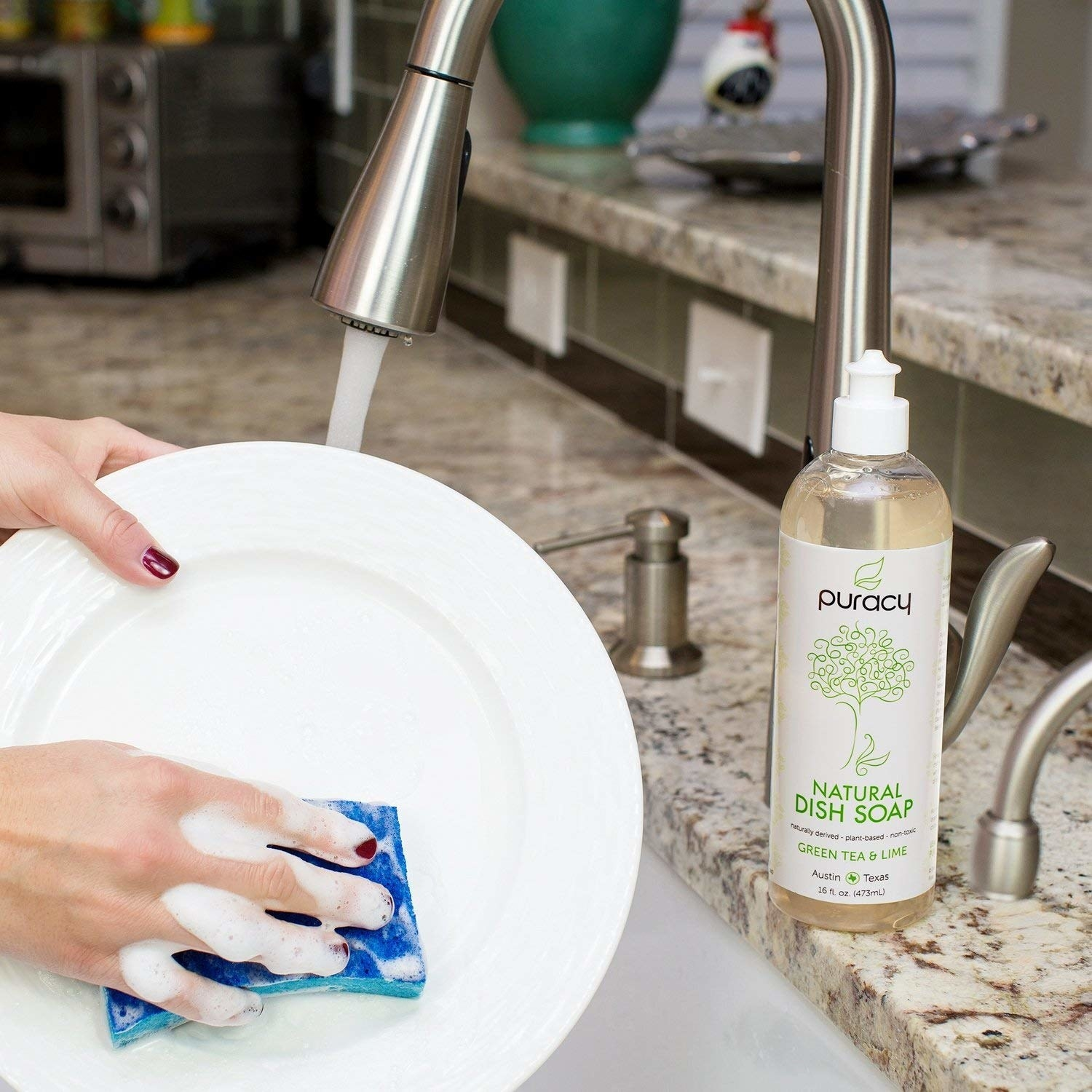Model washing plate with Puracy natural dish soap on counter