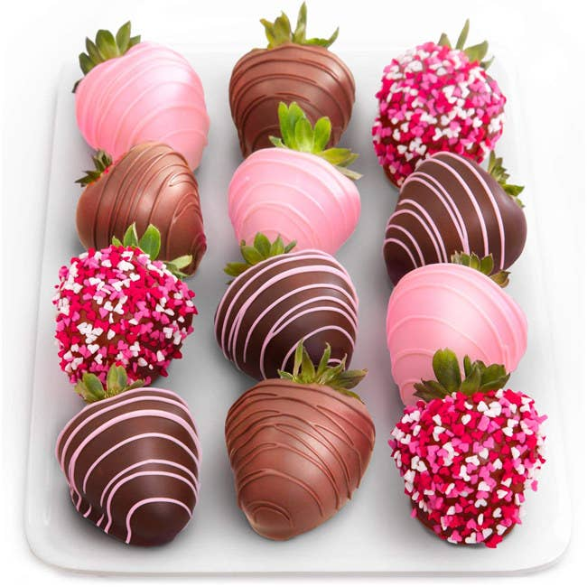 """The pack includes 12 fresh strawberries dipped in premium dark, milk, and pink-tinted white chocolate, and decorated with chocolate drizzle and heart sprinkles.Promising review: """"I ordered these for my sister. She loved them and said they were juicy and delicious! The shipping was really fast, too. I was worried they would arrive melted or crushed, but they were beautiful!"""" —Kimberly Price: $36.51"""