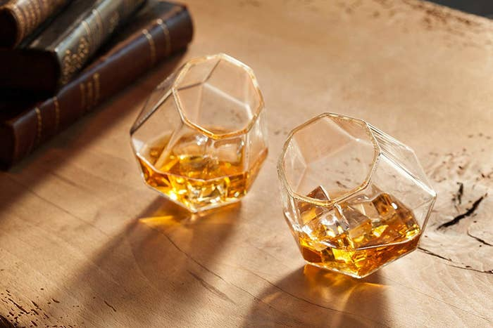 """Promising review: """"They have a nice weight, can be used for wine or scotch, and company always wants to know where I got them. They add a bit of uniqueness to the table, really a special touch!"""" —Jean S.Get a set of two 10 oz glasses from Amazon for $32.99."""