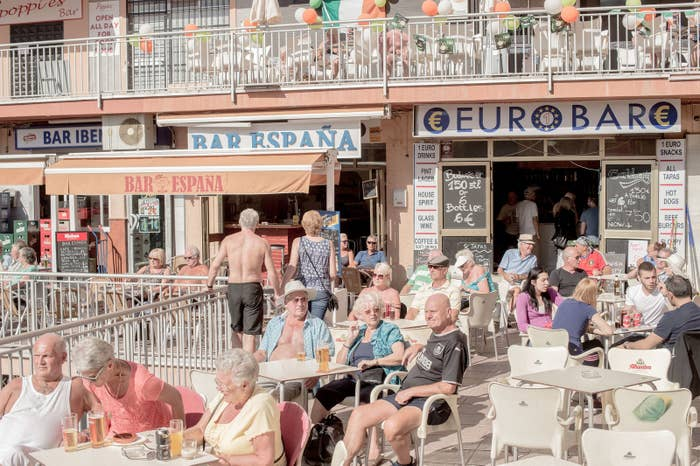 British expats at outdoor bars in Bonanza Square in Benalmádena, Spain.