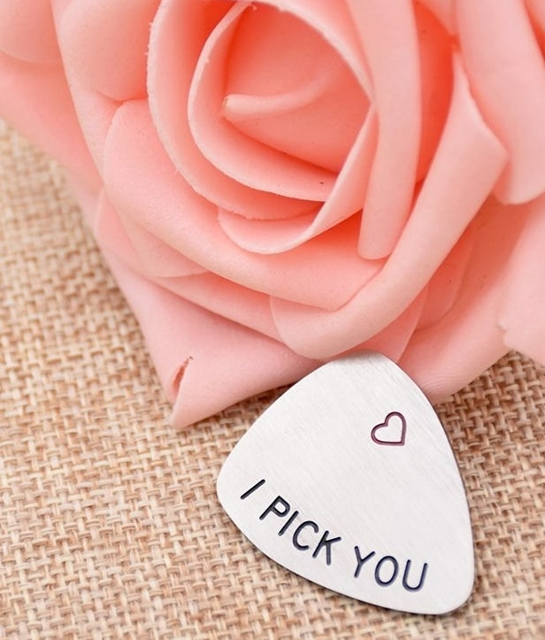 """Meal guitar pick with a heart and the words """" I pick you"""""""