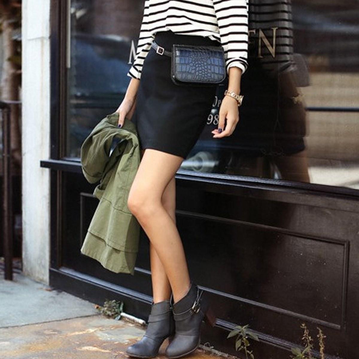 Model wearing faux crocodile bag wrapped around waist