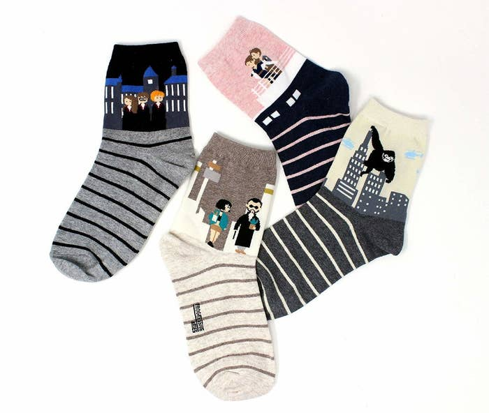 """The only person more excited to get these would be Dobby. They have scenes from Harry Potter, Titanic, King Kong, and Léon The Professional. Promising review: """"I absolutely love these socks. They're great for a fan of these movies. They are also super comfortable. I would buy more of these if the made them for the other movies, too!"""" —Sean NidetchGet a set of four from Amazon for $9.99 (available in six styles)."""