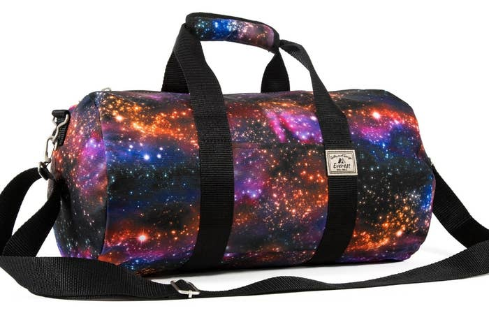 f68720d443 An adorable galaxy duffel bag for transporting all of your gym clothes that  smell  out of this world  bad.