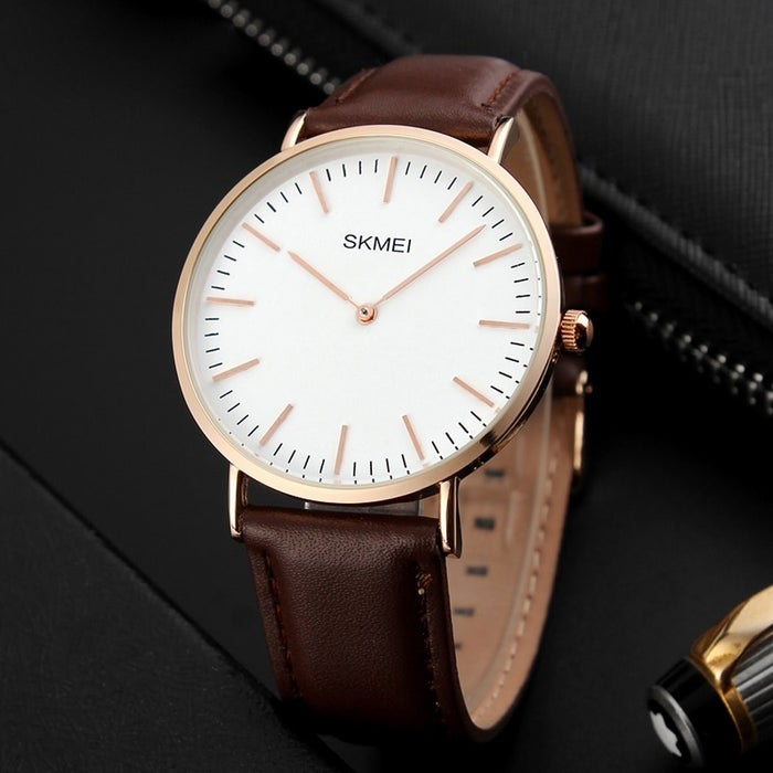 """Get it from Amazon for $14.99.Promising review: """"For a $15 watch, you'd think... This is just a piece of junk! But believe me when I tell you... in this case you don't get what your pay for. This watch is just awesome and very minimalistic. It can go with any outfit and virtually every color. I have given it a lot of use and and it still works and feels like new. The band is really comfortable and given its minimalistic shape, you won't really notice it's there unless you look down. People will ask you where you bought it. They will not expect when you say it was $15."""" —Ramses"""