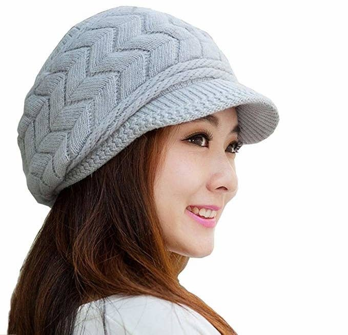 3c3eee77280 A cute ski cap with a visor to keep the sun out of your eyes while you re  hitting the slopes or just to help you look chic on the way to the ...