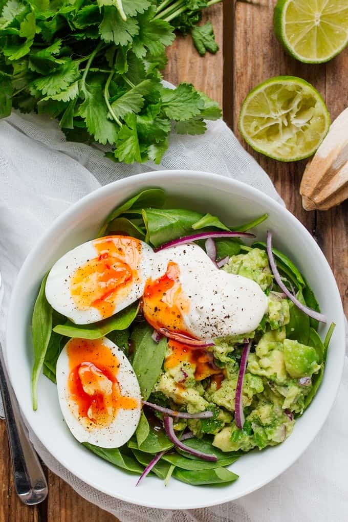 Salad for breakfast? That's right. These delicious and filling morning bowls are packed with spinach, tangy guacamole, and eggs cooked however you like them. Get the recipe.