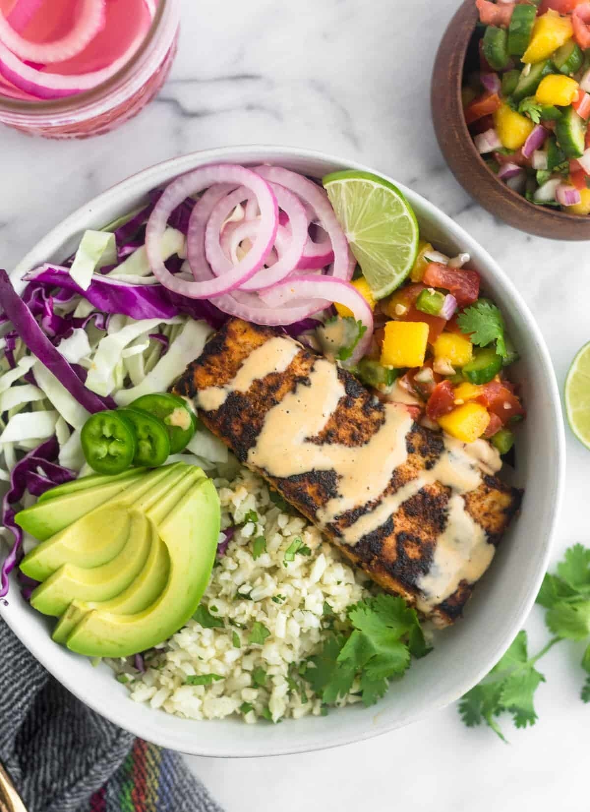 Riced cauliflower and shredded cabbage make a hearty base for these flavorful taco bowls. Opt for any flakey white fish and top the bowls with your favorite toppings like avocado and jalapeño. Get the recipe.