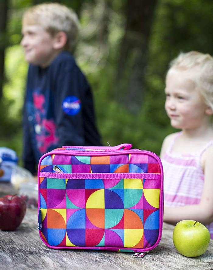 """Promising review: """"I love these Wildkin Lunch boxes! They are the perfect size to fit a real water bottle or thermos, sandwich, chips, apples, etc., or a plastic lunch box container. I also bought the EasyLunchboxes 3-Compartment Bento Lunch Box Containers, Set of 4, Classic and the Fit & Fresh Cool Coolers Slim Penguin Lunch Ice Packs, Multicolored, Set of 4, and they work together perfectly. After three quarters of a year of school, these are still in great shape. I bought the Big Dot Aqua and the Butterfly Garden, and they are both adorable. I would buy again!"""" —Book Worm MomPrice: $9.99+ (available in 41 patterns)"""