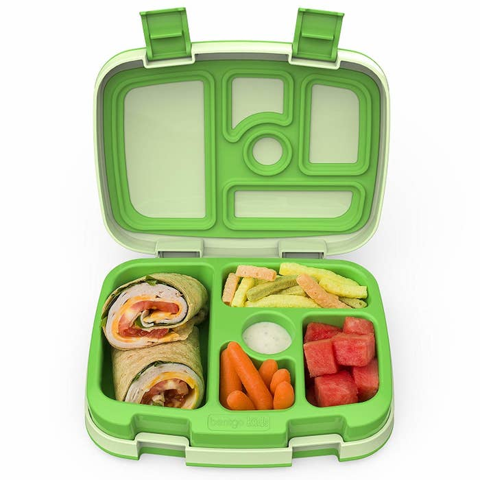 """Just fill the compartments with different foods, lock it, and send it on its way!Promising review: """"This is the perfect lunch box for our kindergartener. It holds enough food to fill her, and it is easy to open and quick to access. We were having trouble using multiple containers with her short lunch break — she'd barely eat! We got this to streamline everything, and she definitely has more time to eat more food when it's all in one place. It's well made and is holding up well so far."""" —brooklynPrice: $27.99 (available in green, blue, and pink)"""