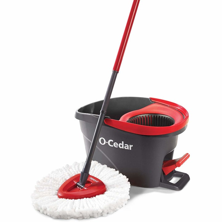 a red and white mop with a black and red bucket