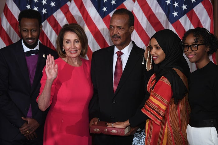 Ilhan Omar, with her hand on the Qur'an, at her ceremonial swearing-in with Speaker of the House Nancy Pelosi on Jan. 3.