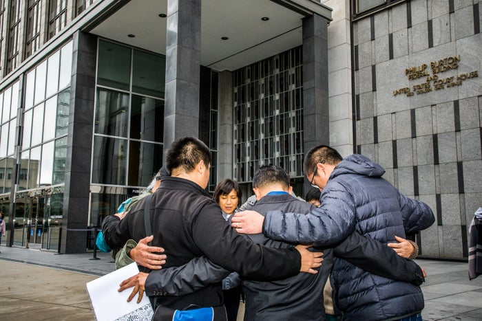 People pray outside a hearing in San Francisco over the deportation of an undocumented immigrant from Cambodia.