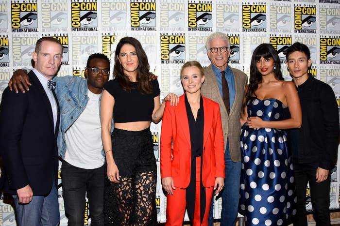 Marc Evan Jackson (left), William Jackson Harper, D'Arcy Carden, Kristen Bell, Ted Danson, Jameela Jamil, and Manny Jacinto attend The Good Place press line during Comic-Con International 2018.