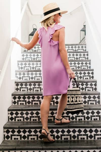 de9c6c6e9d2 A super soft jersey T-shirt dress with a ruffled back you ll be amazed can  be so cute and so comfy all at once.