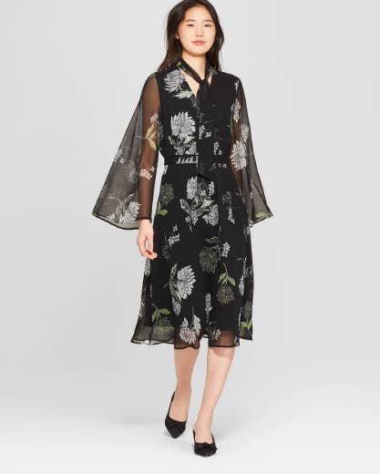 f2713b0a1b7 A sheer-sleeved midi that looks straight off the runway (but is actually  under  50 bucks).