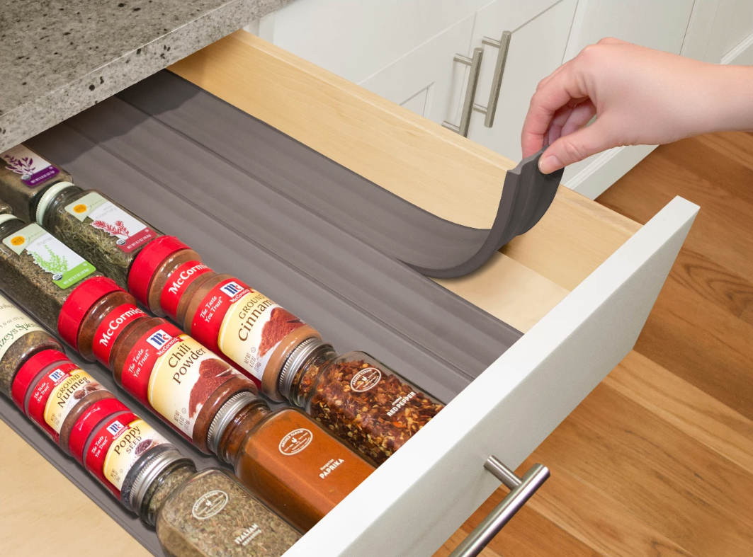 Spice racks only *wish* they could. These drawer liners are made of a soft foam to keep your jars in the right position (label up!) so you can quickly grab what you need. And you can trim 'em to fit your drawers!Get a six-pack from Walmart for $12.99.