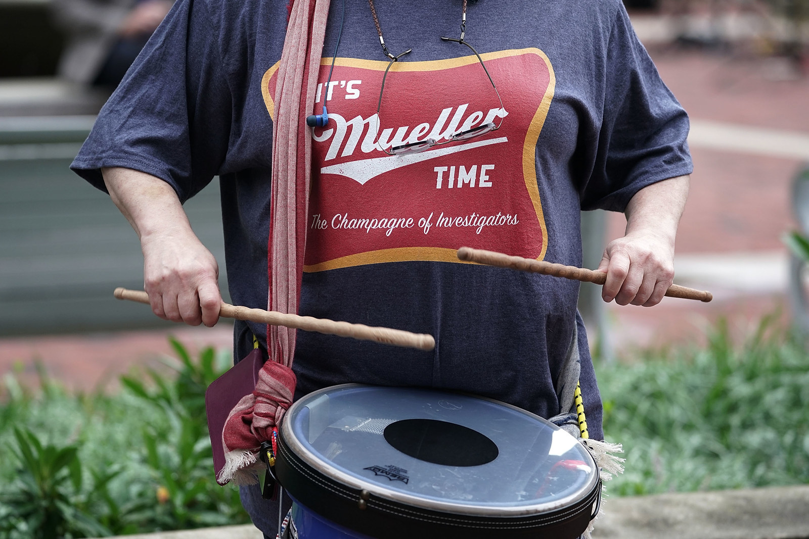 "An activist wears an ""It's Mueller Time"" T-shirt as she hits a drum during a protest outside the Albert V. Bryan United States Courthouse prior to the first day of the trial of former Trump campaign chairman Paul Manafort July 31, 2018 in Alexandria, Virginia."