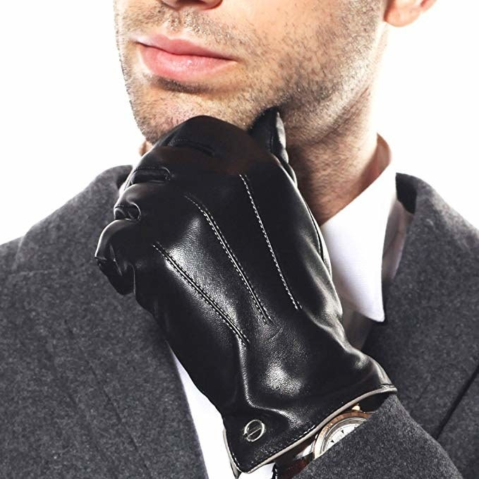 """Promising review: """"Great gloves at a decent price. I got the black with cashmere lining and they are pretty comfortable and warm. I have smaller hands and I ordered size 8.5 thinking it would be about right because I didn't actually bother to measure my hands. It turned out to be just about right with the exception that I get a little wedge of extra room at the tip of my thumbs, but the rest of my hand fits just right and they probably would have been too tight if I had gone a size smaller. The touchscreen fingers work with the thumb, index, and middle fingers just don't expect to be super accurate when using them. If you are worried that they will be super shiny like in the pictures, don't worry they are not that shiny at all. Overall pretty satisfied, would definitely recommend a pair, just take the time to measure your hand."""" —Original user namePrice: $22.99+ (available in six color combos and sizes 8–10)Also check out another pair of leather driving gloves in a different design for cheaper."""