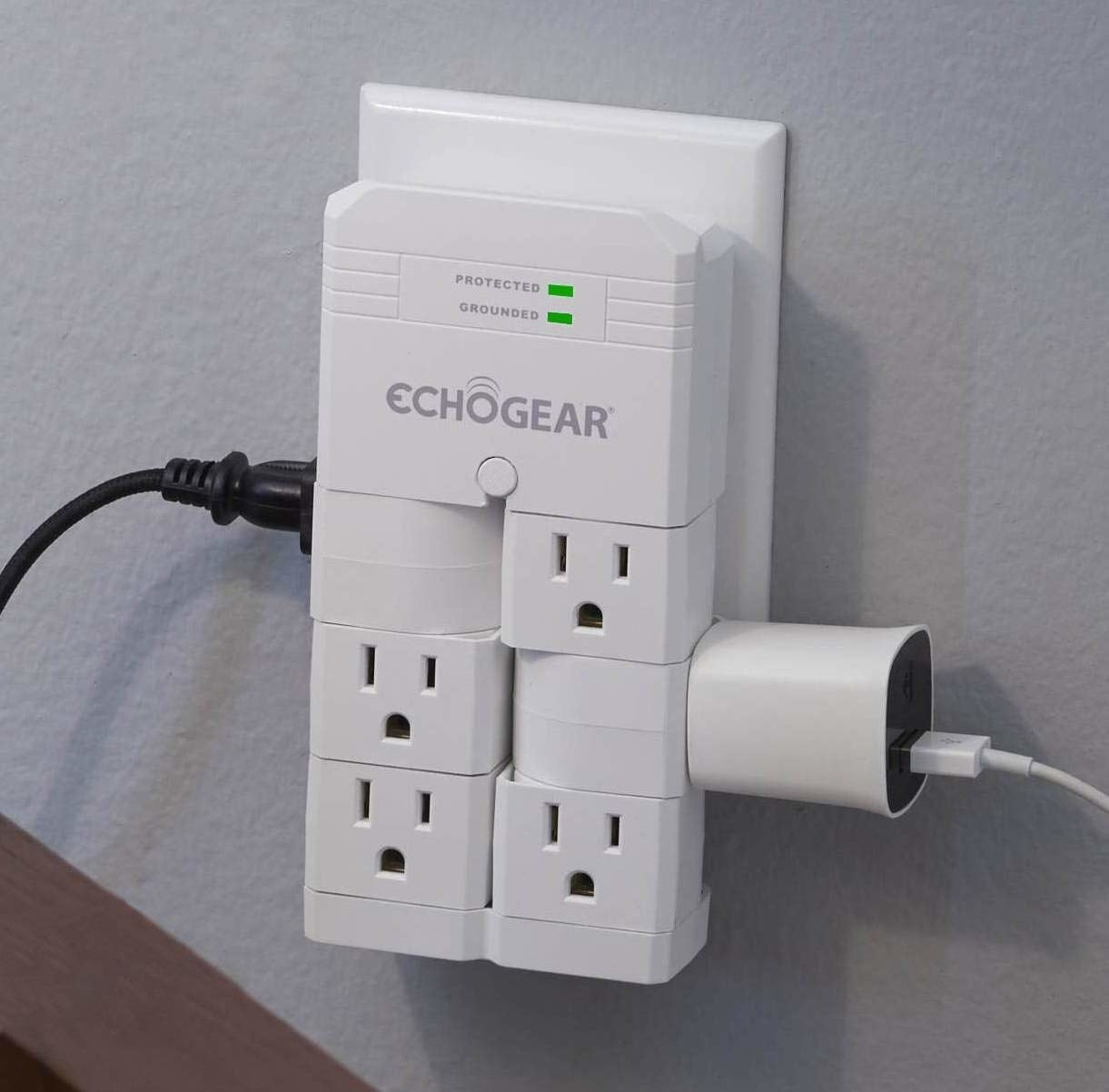 Surge protector with six outlets on wall