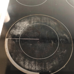 a reviewer's stove top before being cleaned looking scratched