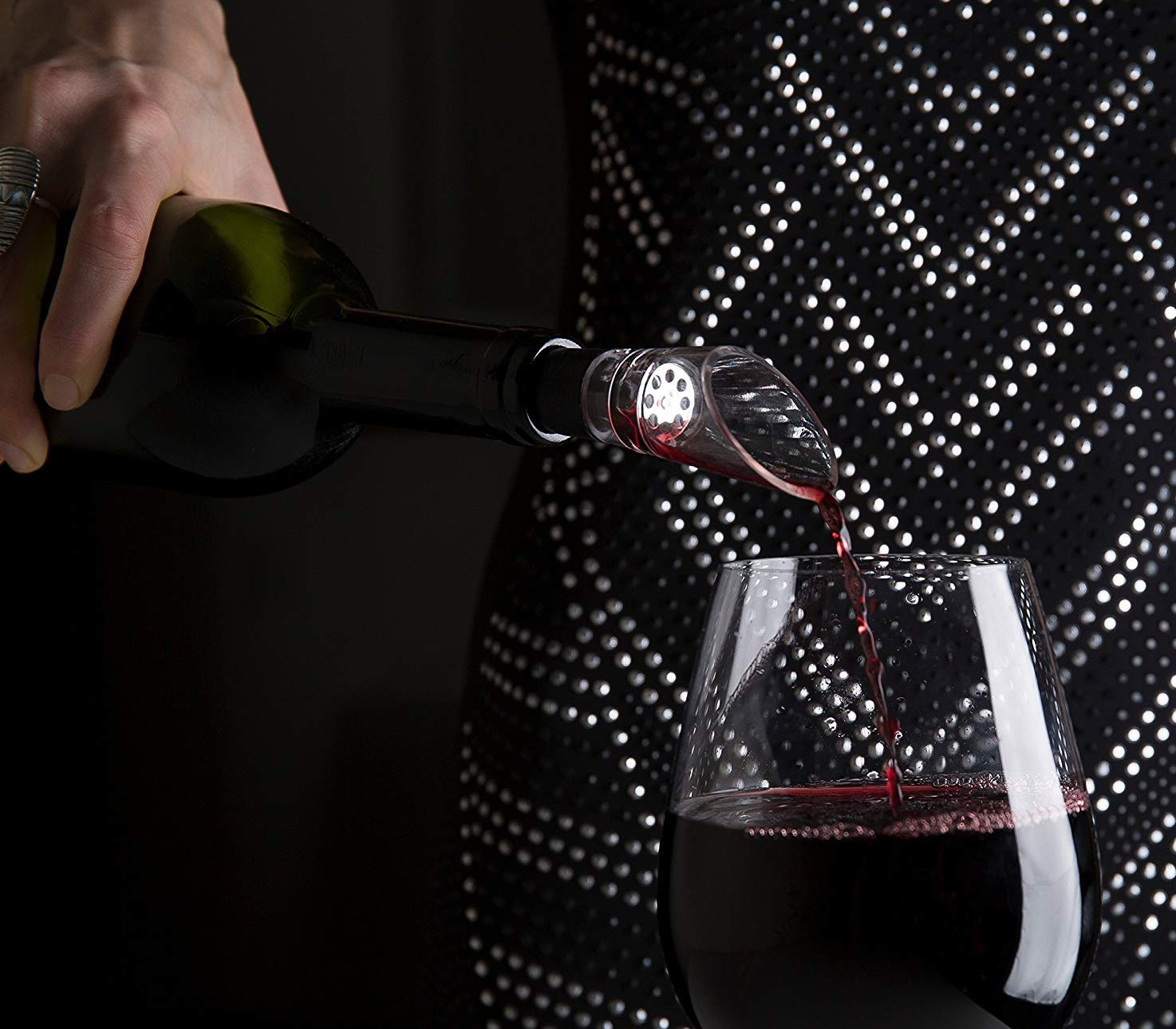 Wine being poured into glass with aerator