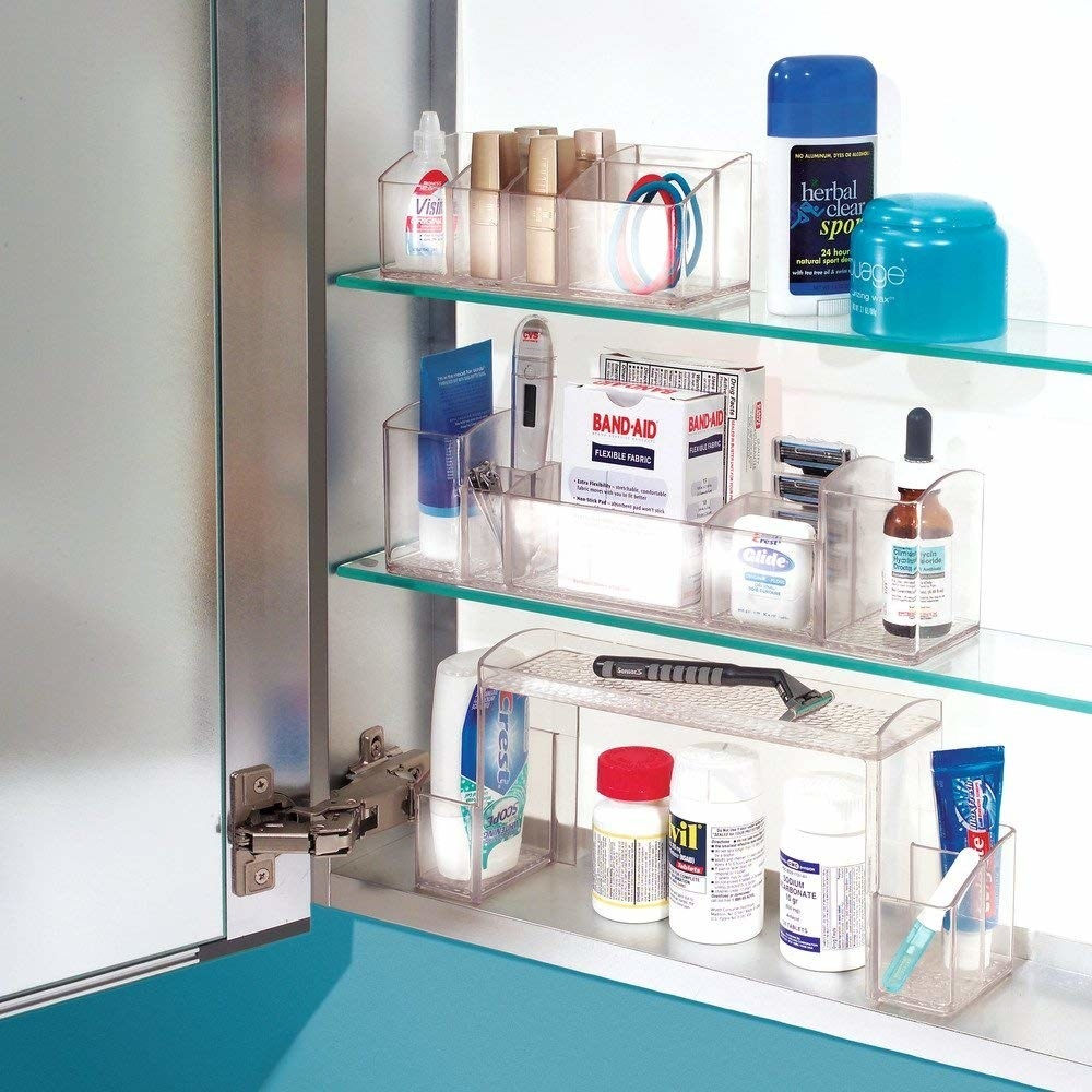 High-rise organizer inside of a medicine cabinet