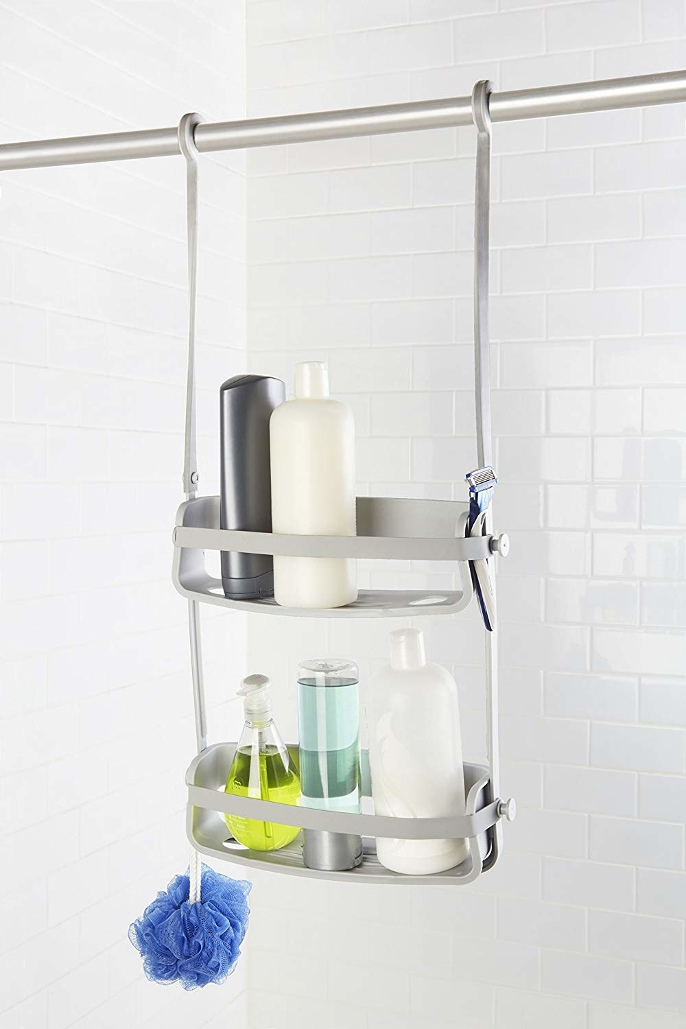 Gray shower caddy with shampoos and loofah